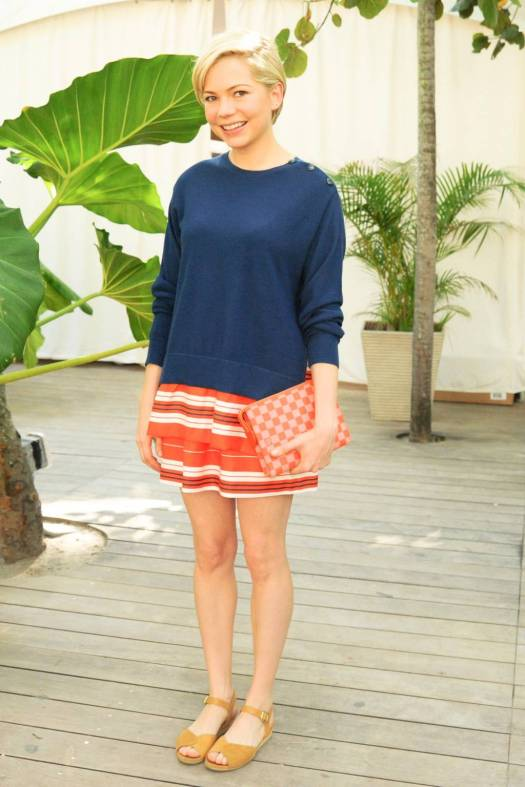Navy jumper over orange and white striped dress