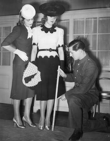 British dress designer Hardy Amies (1909 - 2003) takes time out from his officer training to prepare his spring collection. (Photo by Fred Ramage/Getty Images)